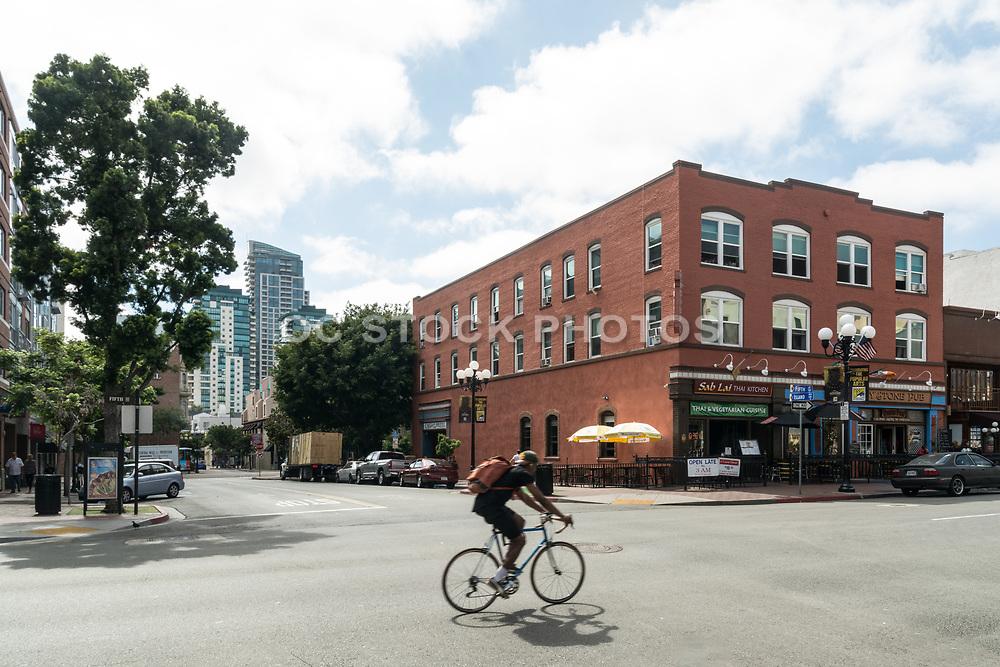 Biker Riding Through Gaslamp Quarter District In Downtown San Diego