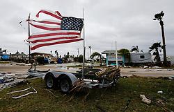 August 27, 2017 - Port Aransas, Texas, U.S. - A tattered U.S. flag blows in the wind in the aftermath of Hurricane Harvey in Port Aransas. (Credit Image: © Kin Man Hui/San Antonio Express-News via ZUMA Wire)