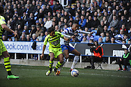 Yeovil Town's Duane Holmes challenges Jordan Obita of Reading for the ball during the Skybet championship match, Reading v Yeovil Town at the Madejski Stadium in Reading, Berkshire on Saturday 1st March 2014.<br /> pic by Jeff Thomas, Andrew Orchard sports photography.