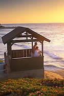 Couple watches the sunset from+Scripps Park, La Jolla, San Diego County, CALIFORNIA