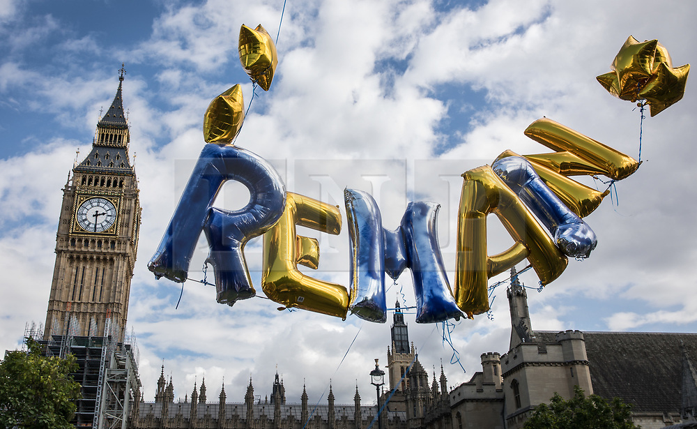 © Licensed to London News Pictures. 09/09/2017. London, UK. Helium balloons spell out 'REMAIN' during the pro-EU People's March For Europe in Parliament Square. Speakers including Sir Bob Geldof, Sir Ed Davey and Liberal Democrat leader Vince Cable will address a rally in Parliament Square. Photo credit: Peter Macdiarmid/LNP