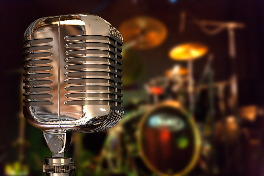 3D rendering of a retro vintage microphone on the stage with a blured drums set in the back.