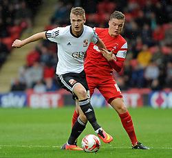 Swindon Town's Michael Smith battles with Leyton Orient's Shane Lowry - photo mandatory by-line David Purday JMP- Tel: Mobile 07966 386802 - 04/10/14 - Leyton Orient  v Swindon Town - SPORT - FOOTBALL - Sky Bet Leauge 1  - London -  Matchroom Stadium
