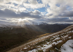 © Licensed to London News Pictures. 30/12/2014.  Elidir Fawr, Wales.   Walkers enjoy one of the peaks in the Snowdon National Park today.  Photo credit : Alison Baskerville/LNP