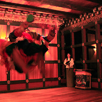 Asia, Bhutan, Paro. Traditional Bhutanese Dance in which the males jump.