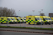 General view of London Ambulances in a car park next to NHS Nightingale a 4,000 bed field hospital in Londons Excel Centre in the battle against coronavirus. NHS Nightingale has been erected with help of the military  in London's Docklands, will initially contain 500 beds with ventilators and oxygen to treat seriously ill patients and ultimately has capacity for 4,000 patients across two wards.