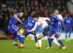 Tottenham Hotspur's Son Heung-min (centre)and Leicester City's Ricardo Pereira battle for the ball during the Premier League match at the King Power Stadium, Leicester.