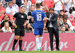 Chelsea's Olivier Giroud shakes hands with manager Antonio Conte after being taken off