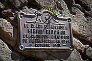 Sign at the entrance to the Citadel at Machu Picchu, which was an Inca city in the Andes mountains. Sign tells of the Hiram Bingham discovery in 1948