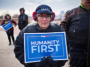 """10 DECEMBER 2019 - DES MOINES, IOWA: Supporters of Andrew Yang wait in the cold in front of the Iowa State Capitol for Yang to arrive at the kickoff of his bus tour. The temperature at the time was about 20F. Yang's supporters frequently wear hats with MATH embroidered on them. MATH is one of the slogans of his campaign and stands for """"Make America Think Harder."""" Yang, an entrepreneur, is running for the Democratic nomination for the US Presidency in 2020. He kicked off a five day bus tour today at the Iowa State Capitol in Des Moines. Iowa hosts the the first election event of the presidential election cycle. The Iowa Caucuses will be on Feb. 3, 2020.                 PHOTO BY JACK KURTZ"""