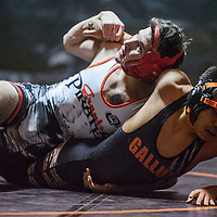 Grants Pirate Joshua Bustos twists Gallup Bengal Brandon James onto the mat Wednesday at Gallup High School.