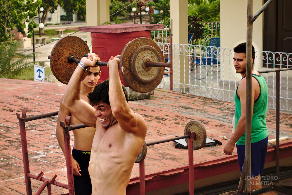 Young men working out in a improvised home gym