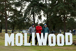 Fans pose in front of the Moliwood sign during day two of the British Masters at Walton Heath Golf Club, Surrey.
