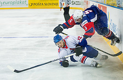 Robert Dowd of Great Britain vs Mitja Robar  of Slovenia during ice-hockey match between Great Britain and Slovenia at IIHF World Championship DIV. I Group A Slovenia 2012, on April 15, 2012 in Arena Stozice, Ljubljana, Slovenia. (Photo by Vid Ponikvar / Sportida.com)