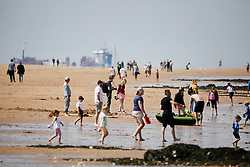 © Licensed to London News Pictures. 17/05/2020. Broadstairs, UK. Visitors to the beach at Broadstairs in Kent enjoy the sunshine. Some lockdown rules have been relaxed to allow people to travel further to exercise and to sunbathe. Photo credit: Marcin Nowak/LNP