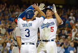 July 28, 2017 - Los Angeles, California, U.S. - Los Angeles Dodgers' Corey Seager (5) high fives teammate Chris Taylor (3) after hitting a two run home run agains the San Francisco Giants in the seventh inning of a Major League baseball game at Dodger Stadium on Friday, July 28, 2017 in Los Angeles. (Photo by Keith Birmingham, Pasadena Star-News/SCNG) (Credit Image: © San Gabriel Valley Tribune via ZUMA Wire)