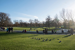 © Licensed to London News Pictures. 22/11/2020. London, UK. Visitors enjoy the Diana, Princess of Wales Memorial Fountain on a sunny Sunday afternoon in Hyde Park during the second Covid-19 lockdown. Photo credit: London News Pictures