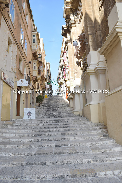 Steps in Valetta with shops and terrance houses