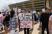 A student holds a sign up during the March for Our Lives event in front of Dallas City hall on Saturday.