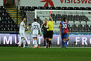Swansea city's  Chico Flores (l) is sent off by referee Mike Dean.  Barclays Premier league, Swansea city v Crystal Palace match at the Liberty Stadium in Swansea, South Wales on Sunday 2nd March 2014.<br /> pic by Andrew Orchard, Andrew Orchard sports photography.