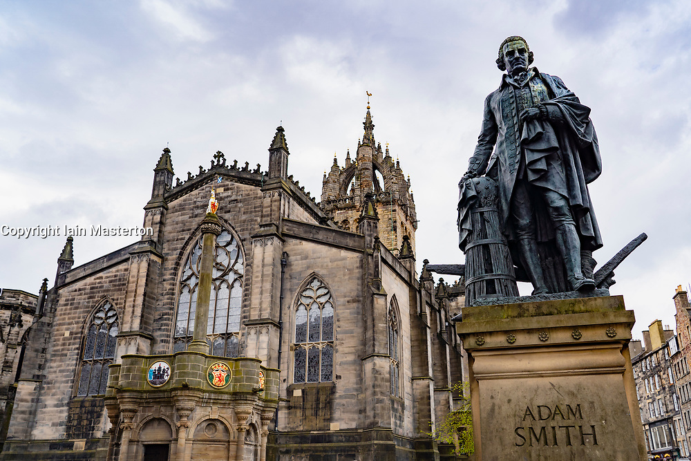 View of statue of Adam Smith with St Giles Cathedral to rear on the Royal Mile in Edinburgh Old Town, Scotland, UK