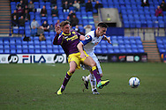 Notts County's Gary Liddle and Tranmere Rovers' Jake Cassidy (r) battle for the ball. Skybet football league one match, Tranmere Rovers v Notts county at Prenton Park in Birkenhead, England on Saturday 15th March 2014.<br /> pic by Chris Stading, Andrew Orchard sports photography.