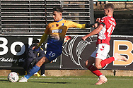Tyler Walker of Mansfield Town (19) crosses the ball with Toby Stevenson of Charlton Athletic (43) challenging during the The FA Cup match between Mansfield Town and Charlton Athletic at the One Call Stadium, Mansfield, England on 11 November 2018.