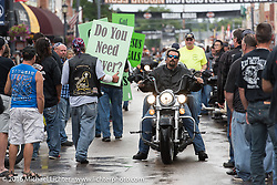 Religious group on Main Street during the annual Sturgis Black Hills Motorcycle Rally. SD, USA. Thursday, August 11, 2016. Photography ©2016 Michael Lichter.