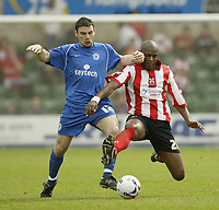 Photo: Aidan Ellis.<br /> Lincoln City v Rochdale. Coca Cola League 2. 06/05/2006.<br /> Lincoln's Marvin robinson challenges Rochdale's Alan Goodall