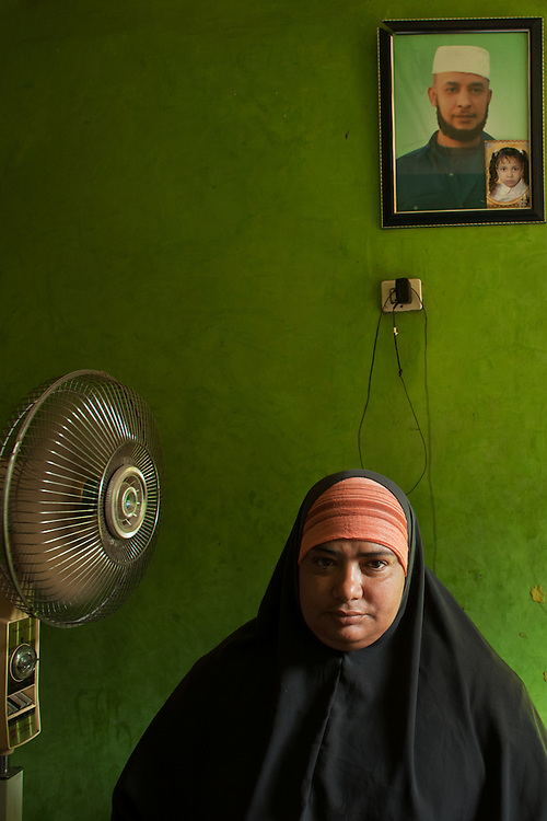 """On Saturday, January 29, Um Adel Ezbet Abu Hashish watched as her husband spoke on a cell phone to their incarcerated son, Adel Mahmoud, to confirm what his prison mates had conveyed in an earlier call: """"officers are shooting us inside the prison, there are dead bodies lying around the cells and prison corridors.""""  Shortly thereafter, he was shot and killed.  She now cares for Adel's son and two daughters in her small apartment on the top floor of an old and decaying building in Old Cairo.  She is also working to bring Adel's case to court, and has faced a great deal of resistance from the military, who has repeatedly attempted to cover up the incident - from painting over bullet holes to delaying the collection of evidence in prisons."""