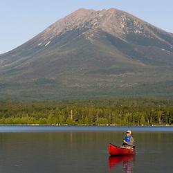 Canoeing on Maine's Katahdin Lake below Mount Katahdin, the highest point in Maine.  Near Baxter State Park.
