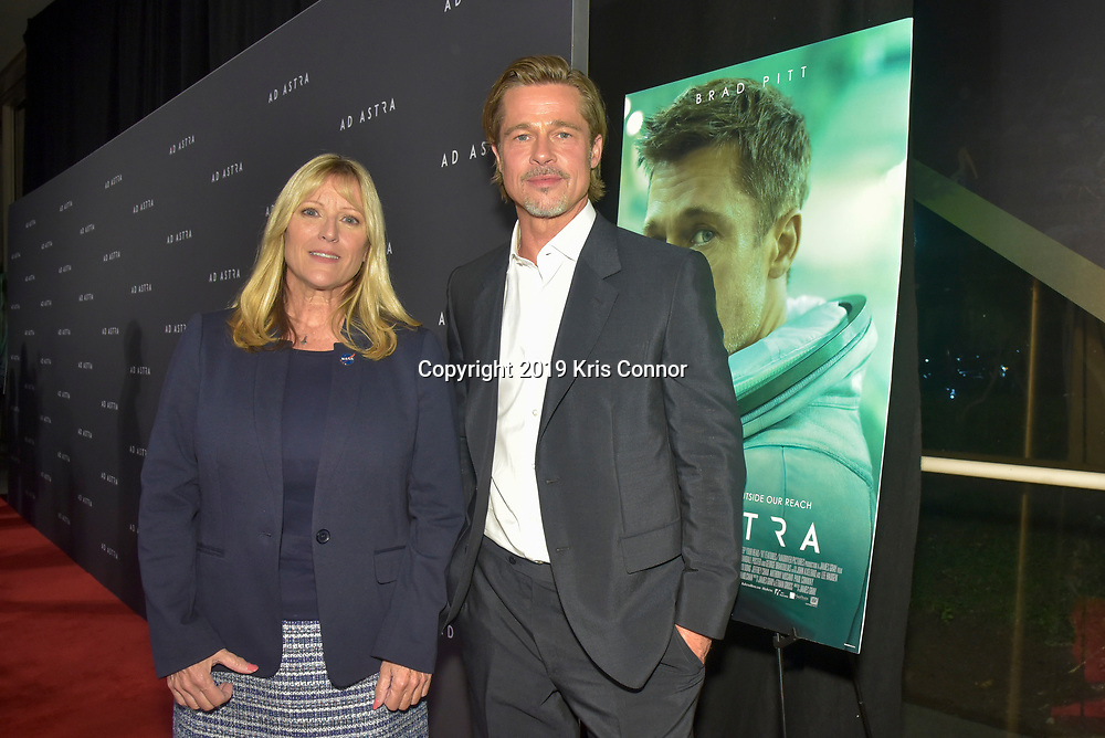 """WASHINGTON DC: Former NASA Astronaut Kay Hire and actor Brad Pitt attend the 20th Century Fox's and New Regencies special screening of """"AD ASTRA """" movie at the National Geographic Museum  on September 16, 2019 in Washington DC. A paranoid thriller in space that follows Roy McBride (Brad Pitt) on a mission across an unforgiving solar system to uncover the truth about his missing father and his doomed expedition that now, 30 years later, threatens the universe. (Photo by Kris Connor/20th Century Fox)"""