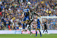 Jake Reeves of AFC Wimbledon heads the ball over Hiram Boateng of Plymouth Argyle. Skybet football league two play off final match, AFC Wimbledon v Plymouth Argyle at Wembley Stadium in London on Monday 30th May 2016.<br /> pic by John Patrick Fletcher, Andrew Orchard sports photography.