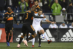 October 8, 2018 - Seattle, Washington, U.S - Seattle midfielder VICTOR RODRIGUEZ (8) gets pressure from Houston's ADOLFO MACHADO (3) as the Houston Dynamo visits the Seattle Sounders in a MLS match at Century Link Field in Seattle, WA. Seattle won the match 4-1. (Credit Image: © Jeff Halstead/ZUMA Wire)