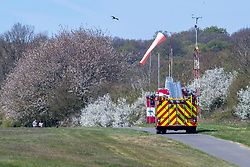 © Licensed to London News Pictures. 26/04/2021. High Wycombe, UK. A fire appliance at the scene of a light aircraft crash at Wycombe Air Park, also known as Booker Airfield, the incident occurred at approximatly 10:30 BST when a plane crashed through bushes at the end of the runway coming to rest in a field. Photo credit: Peter Manning/LNP