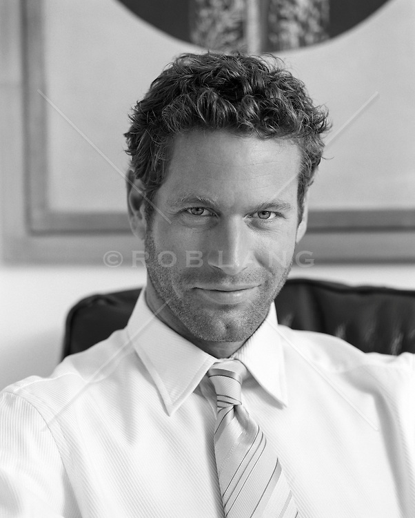 portrait of a handsome all american man in a shirt and tie at home