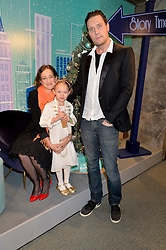 LEAH WOOD, her daughter MAGGIE DYLAN and JACK MacDONALD at the official opening of the 2014 Tiffany & Co.Christmas Shop on Bond Street, London on 16th November 2014.
