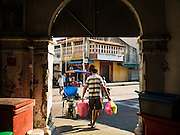 17 NOVEMBER 2016 - GEORGE TOWN, PENANG, MALAYSIA:  A shopper leaves the Campbell Street Market, one of the few remaining traditional markets in George Town, Penang, Malaysia. George Town is a UNESCO World Heritage city and wrestles with maintaining its traditional lifestyle and mass tourism.       PHOTO BY JACK KURTZ