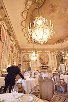 Waiter Sebastien setting up of tables at the Restaurant Meurice in Paris....photo by Owen Franken......May 26, 2004