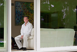 """Dr. Stephane Huberty, at his home in Rixensart, Belgium, on August 7, 2010. Dr. Huberty suffers from myasthenia gravis, a rare neurological condition. It is one of more than 5,000 """"orphan"""" diseases, so called because there are so few sufferers that most pharmaceutical companies are reluctant to invest in cures. The 48-year-old Belgian doctor, who has had the disease for 14 years, has been taking medication he and others developed, but he can't find investors to pay for a clinical trial. Pharmaceutical companies and other doctors say his product is unproven. So Dr. Huberty is taking a leaf out of 19th- century science and using himself as a guinea pig, and the results have been very positive. (Photo © Jock Fistick)"""