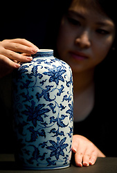© London News Pictures. 04/11/2011. London, UK. A rare white and blue cylindrical vase (1723-1739) expected to fetch £500,00 to £700,000 at a Christie's auction of Fine Chinese Ceramics and Works of Art on November 8th 2011. The auction, which is led by seven private collections, is expected to realise in excess of £15 million. Photo Credit : Ben Cawthra/LNP