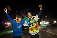 """2 people run at 6:00 AM on the 20th Korrika. Baltierra (Basque Country). April 1, 2017. The """"Korrika"""" is a relay course, with a wooden baton that passes from hand to hand without interruption, organised every two years in a bid to promote the basque language. The Korrika runs over 11 days and 10 nights, crossing many Basque villages and cities. This year was the 20th edition and run more than 2500 Kilometres. Some people consider it an honour to carry the baton with the symbol of the Basques, """"buying"""" kilometres to support Basque language teaching. (Gari Garaialde / Bostok Photo)"""