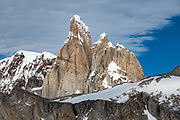 """Paso Quadrado affords a view south to Cerro Torre, near El Chalten, Argentina, Patagonia, South America. We hiked scenic Rio Electrico Valley to Refugio Piedra del Fraile (""""Stone of the Friar"""", 14.5 km round trip) to stay overnight in dorms. A path from the refuge ascends very steeply to Paso Quadrado (gaining 1340 m vertically in 8.4 km round trip). The last kilometer climbs up steep snow which could require crampons if icy (but was passable in soft snow using our trailrunning shoes). Views keep improving as you ascend. Monte Fitz Roy is also known as Cerro Chaltén, Cerro Fitz Roy, or Mount Fitz Roy (3405 m or 11,171 ft elevation). The first Europeans recorded as seeing Mount Fitz Roy were the Spanish explorer Antonio de Viedma and his companions, who in 1783 reached the shores of Viedma Lake. In 1877, Argentine explorer Francisco Moreno saw the mountain and named it Fitz Roy in honour of Robert FitzRoy who, as captain of HMS Beagle, had travelled up the Santa Cruz River in 1834 and charted large parts of the Patagonian coast. Mt Fitz Roy was first climbed in 1952. Cerro is a Spanish word meaning hill, while Chaltén comes from a Tehuelche word meaning """"smoking mountain"""", due to clouds that usually form around the peak."""