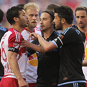 David Villa, (right), NYCFC, argues with Felipe Martins, New York Red Bulls during the New York Red Bulls Vs NYCFC, MLS regular season match at Red Bull Arena, Harrison, New Jersey. USA. 10th May 2015. Photo Tim Clayton