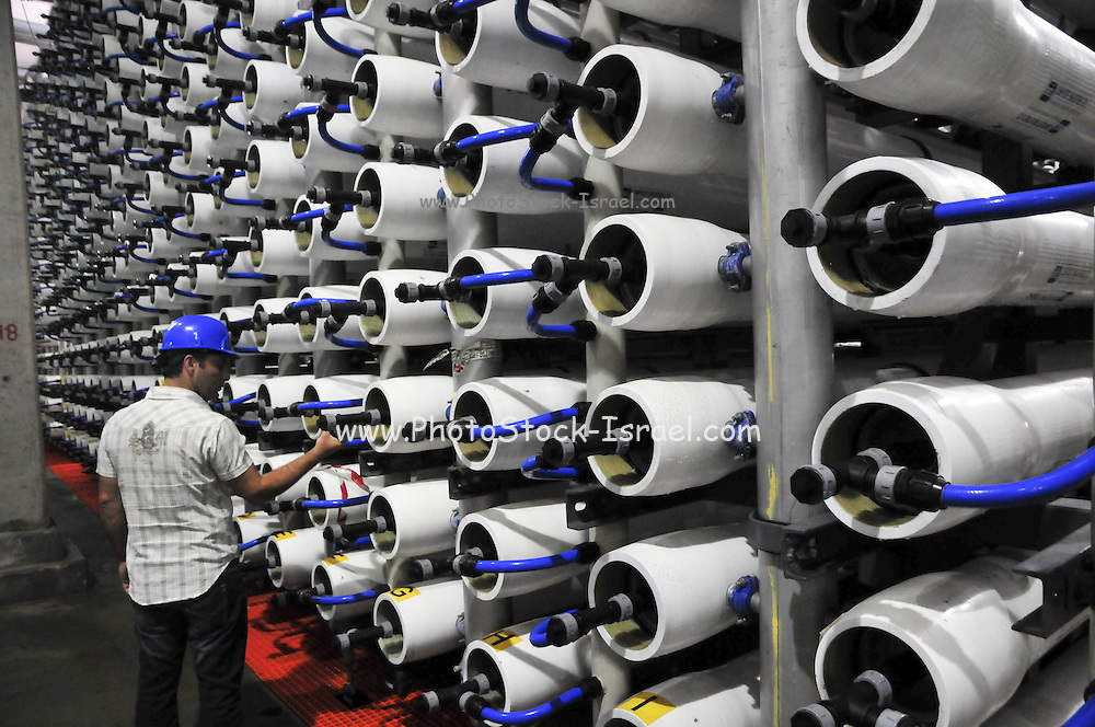 Desalination plant. Engineer inspects the Reverse Osmosis membrane filters. This facility turns salt water into drinking water using the Reverse Osmosis Process and will produce 127 million cubic metres of fresh water each year. Photographed in Hadera, Israel.