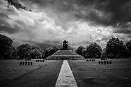 Black and white image of the La Cambe military war grave cemetery, located close to Bayeux, France. It holds more than 21,000 German military personnel of World War II and is maintained and managed by the German War Graves Commission. 207 unknown and 89 identified German soldiers are buried in the mound in the center.