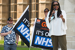 Dawn Butler, Labour MP for Brent Central, addresses NHS workers from the grassroots NHSPay15 campaign outside Parliament before a march to 10 Downing Street to present a petition signed by over 800,000 people calling for a 15% pay rise for NHS workers on 20th July 2021 in London, United Kingdom. At the time of presentation of the petition, the government was believed to be preparing to offer NHS workers a 3% pay rise in 'recognition of the unique impact of the pandemic on the NHS'.
