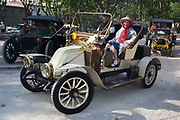 A 1908 Renault Type AX vintage car visits a rural French village, during a three-day rally journey through the Corbieres wine region, on 26th May, 2017, in Lagrasse, Languedoc-Rousillon, south of France. Lagrasse is listed as one of Frances most beautiful villages and lies on the famous Route 20 wine route in the Basses-Corbieres region dating to the 13th century.