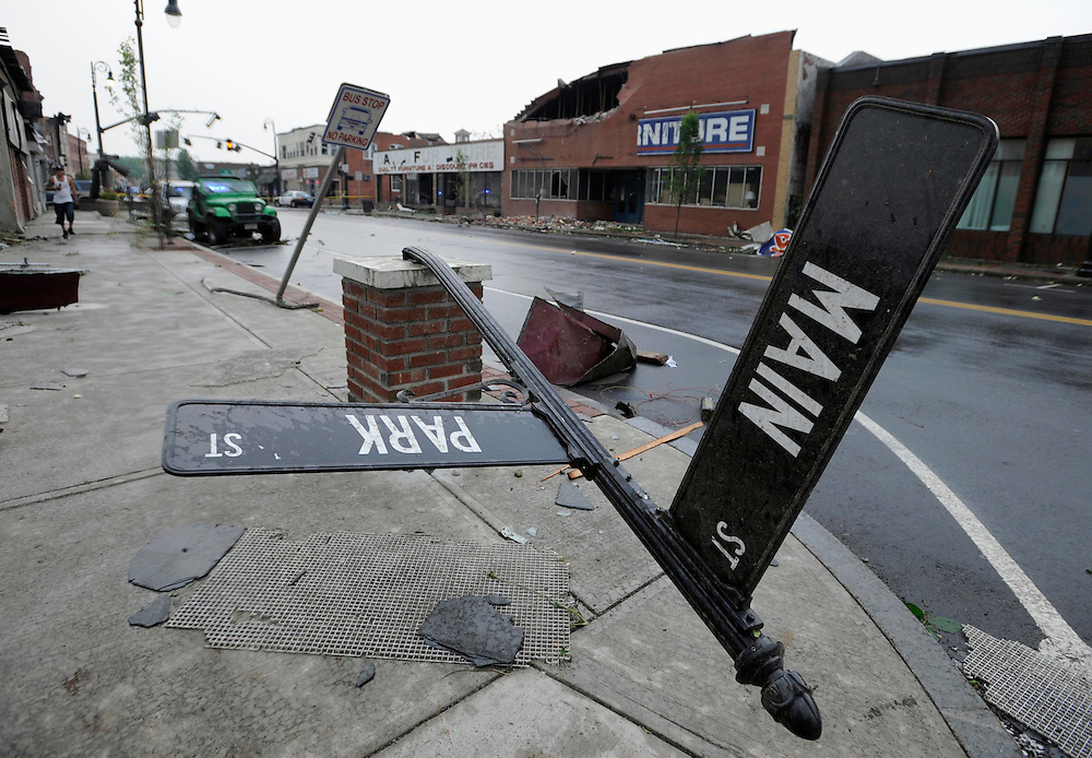 Storm damage is seen in downtown Springfield, Mass., Wednesday, June 1, 2011. An apparent tornado struck the downtown of one of the state's largest cities on Wednesday afternoon, scattering debris, toppling trees and frightening workers and residents. Several injuries were reported. (AP Photo/Jessica Hill)