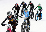 SHOT 2/9/13 5:38:42 PM - Judy Freeman (#230) of Boulder, Co. climbs with a group of cyclists during the On-Snow Mountain Bike Crit at the second annual Winter Mountain Games presented by Eddie Bauer at Vail Ski Resort in Vail, Co. Freeman finished first in the Fat Tire Female class. The Winter Mountain Games feature competitions in X-Country On-Snow Mountain Bike Races, mixed climbing, Telemark Big Air,Best Trick Bike and On-Snow Mountain Bike Crit with more than$60,000 in prize money on the line. (Photo by Marc Piscotty / © 2013)